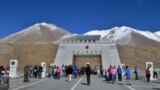 FILE: People gather at the 4730 meter (15,520 ft) high Khunjerab Pass, a high mountain pass, which also seres as border crossing between Chin and Pakistan.
