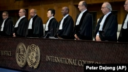 Judges enter the International Court of Justice, or World Court, in The Hague, October 3, 2018