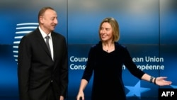 EU foreign-policy chief Federica Mogherini (right) welcomes Azerbaijani President Ilham Aliyev prior to their bilateral meeting at EU headquarters in Brussels on February 6.