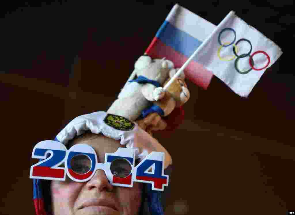 Лица российских болельщиков на соревнованиях в олимпийском Сочи