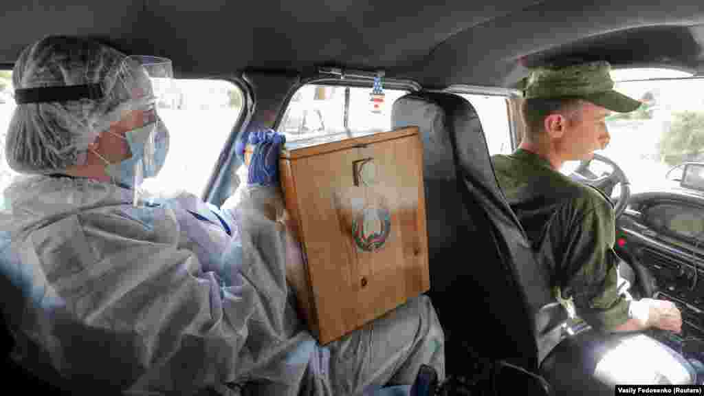 A ballot box is transported on the main day of voting.