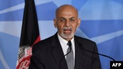 Afghan President Ashraf Ghani makes a statement prior to a meeting at the NATO headquarters in Brussels on December 1.