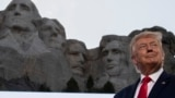 U.S. -- President Donald Trump smiles at Mount Rushmore National Memorial, Friday, July 3, 2020, near Keystone, S.D.
