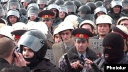 Riot police confront opposition protesters during the March 1, 2008, demonstrations.