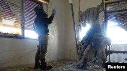 Քիմիական զենքի արգելման կազմակերպության փորձագետները աշխատում են Սիրիայում, օգոստոս, 2013թ․