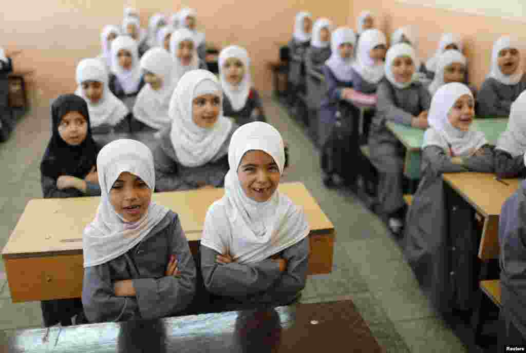 Girls attend classes at an Islamic school. Sadr City bears the name of revered Shi'ite cleric Muhammad al-Sadr, who was killed in 1999, reportedly by agents of the Iraqi regime.