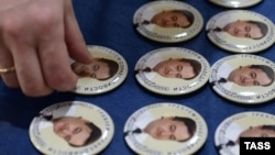 Pins bearing portraits of Sergei Magnitsky, for which the Magnitsky Act was named.