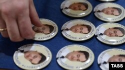 Pins bearing portraits of Sergei Magnitsky and produced by the Moscow Sakharov Center in 2013 to mark the late lawyer's 41st birthday