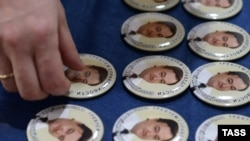 Russia -- Pins bearing portraits of Sergei Magnitsky, an accountant and auditor at the British investment company Hermitage Capital Management, Mosvow, April 8, 2013.