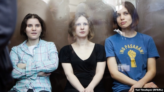 The three convicted members of Pussy Riot in a Moscow courtroom on August 17