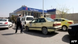 Syrians queue to fill their cars with gasoline at a station in the capital Damascus on April 8, 2019.