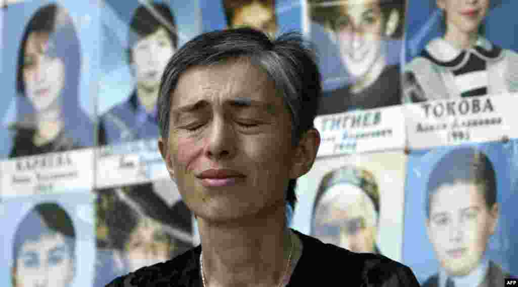 A woman cries in front of a memorial to students killed at School No.1 in Beslan, North Ossetia.