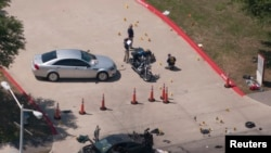 An aerial view shows the area around a car that was used by two gunmen, who were killed by police on May 3.