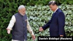 شی جینپینگ، رئیس جمهور چین و نارندرا مودی، نخستوزیر هند