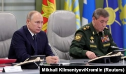 Russian President Vladimir Putin (left) and General Valery Gerasimov hand out warnings to the West with sometimes astonishing regularity.