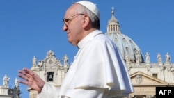 Vatican -- Pope Francis waves from the papamobile during his inauguration mass on St. Peter's square, 19Mar2013