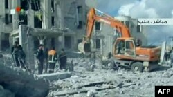 Syrian TV shows rescue work at the scene of a blast in the city of Aleppo on February 10.