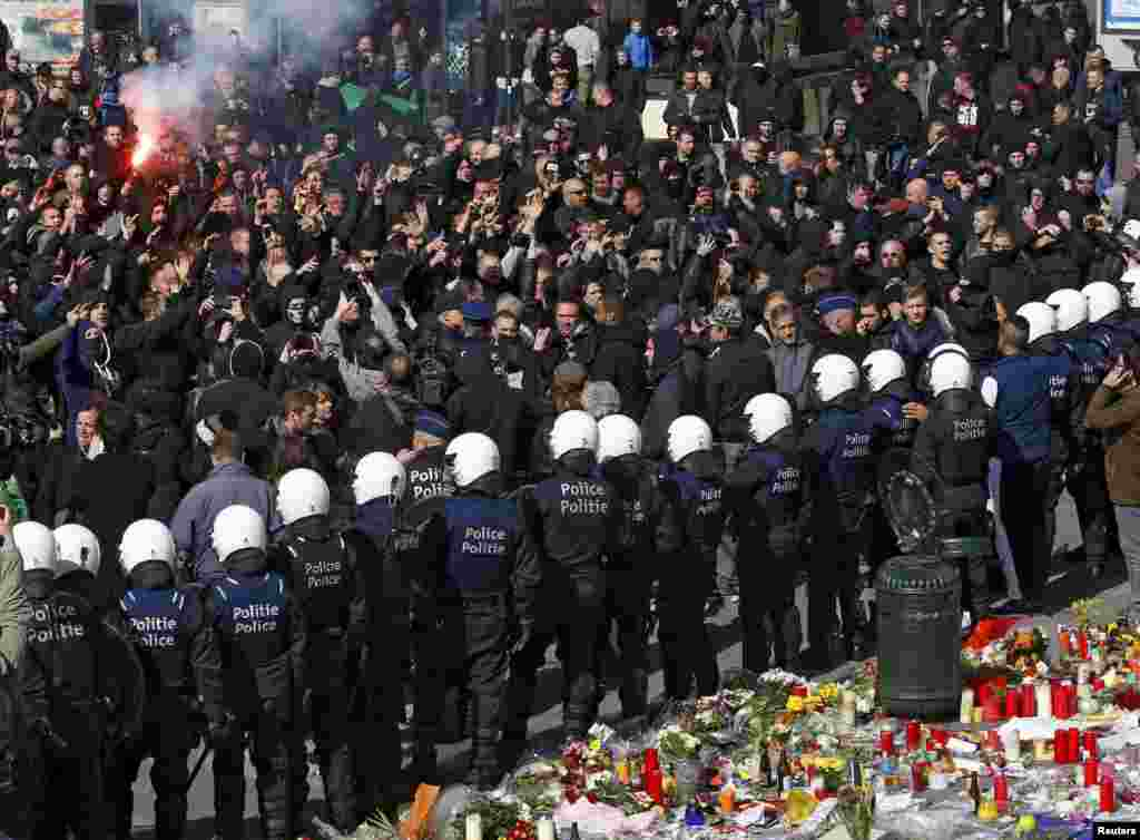 Right-wing demonstrators confront police in front of the old stock exchange in Brussels following deadly bombings in the Belgian capital that killed dozens of people. (Reuters/Yves Herman)