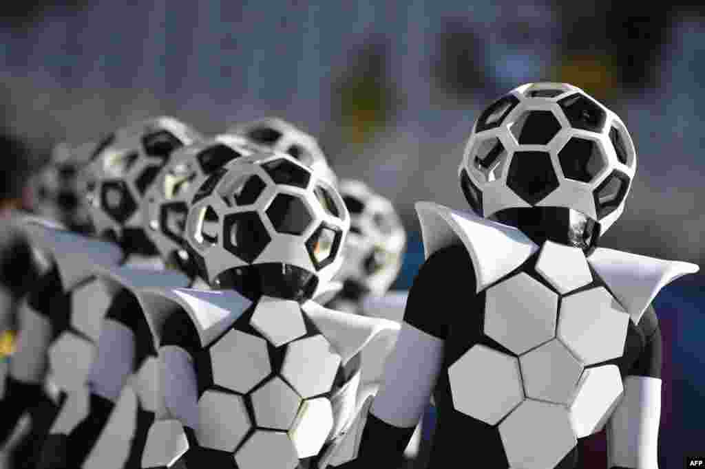 Performers dressed as soccer balls take part in the World Cup's opening ceremony.