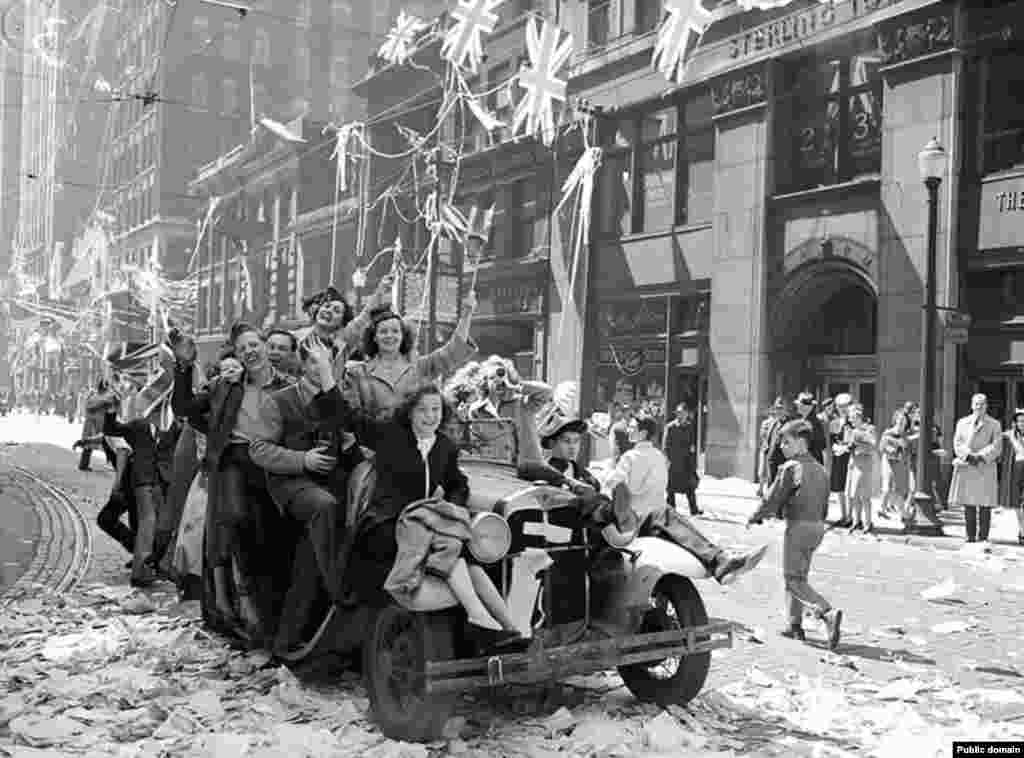 "British revelers roll through London. Mixed with the joy of victory was bittersweet relief. One British woman recalls thinking ""they won't bomb us any more, they won't kill any more of our young men."""