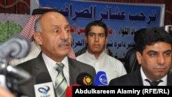 اللواء مارد عبد الحسين يسار الصورة