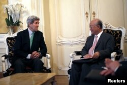 U.S. Secretary of State John Kerry (left) chats with the diirector-general of the International Atomic Energy Agency, Yukiya Amano, during a meeting in Vienna on June 29.