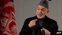 Afghanistan -- President Hamid Karzai speaks at a gathering of women to mark International Women's Day, in Kabul, 10Mar2013