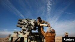 """""""Ислам мамлекети"""" радикал уюмуна каршы согушуп жаткан Ирак күчтөрү."""