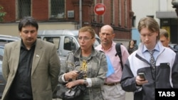 """Yevgenia Debryanskaya (center) with fellow gay-rights activists Edvard Murzin _left) and Nikolai Alekseyev: """"There was a time when we thought we could disband the army, ban the security services, open the borders, and legalize same-sex marriage."""""""