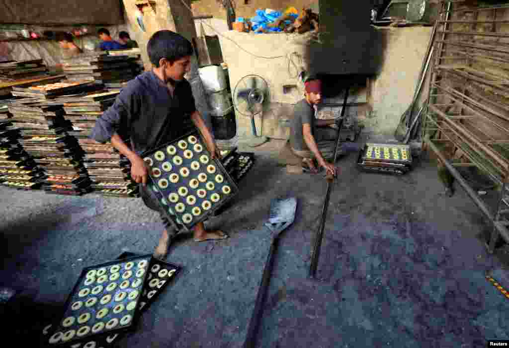 Afghan men make sweets at a traditional factory in Jalalabad. (Reuters/Parwiz)