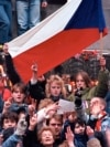 Czechoslovakia -- FILE -- Demonstrators flash victory signs during a protest demanding more freedom and democracy at Wenceslas Square in Prague October 28, 1989. REUTERS/Petar Kujundzic (CZECH REPUBLIC POLITICS CONFLICT) BEST QUALITY AVAILABLE - RTR25H