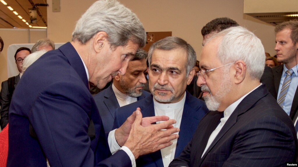 Hossein Fereidoun (center) took part in the talks that led to a 2015 nuclear deal between Iran and world powers. Also pictured: Iranian Foreign Minister Mohammad Javad Zarif (right) and former U.S. Secretary of State John Kerry (left)