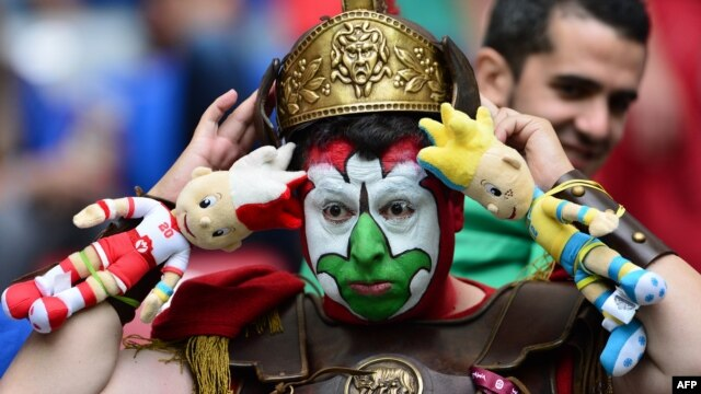 An Italian fan waits for the Euro 2012 semi-final against Germany.