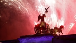 Ukraine -- Fireworks explode over the Quadriga of the Brandenburg Gate during a ceremony marking the 30th anniversary of the fall of the Berlin Wall in Berlin, Germany, November 9, 2019