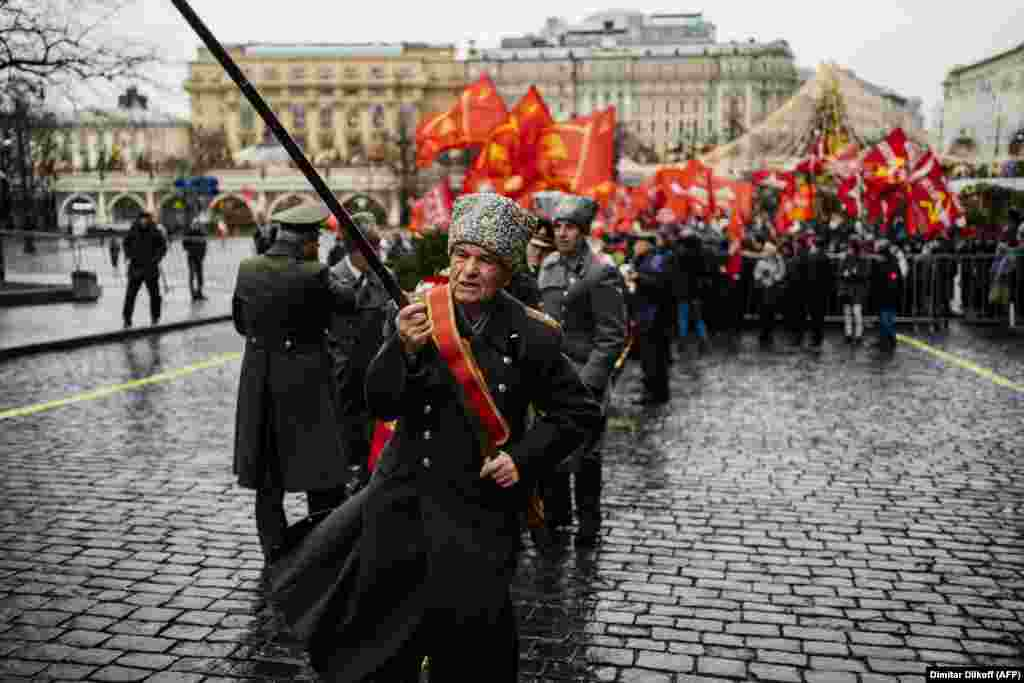 Russian Communist Party supporters holding red flags gather by Red Square to take part in a memorial ceremony to mark the 96th anniversary of the death of Vladimir Lenin, in downtown Moscow, on January 21. (AFP/Dimatar Dilkoff)