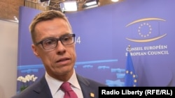 Belgium -- The prime-minister of Finland Oleksandr Stubb on sigining the association agreement at EU Summit, Brussels, 27June2014