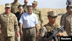 U.S. Secretary of Defense Leon Panetta (center) leaves a meeting with ISAF troops during his Afghanistan visit on March 14.