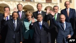 World leaders wave as they pose for a group picture at the G20 summit in St. Petersburg last month.