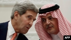 U.S. Secretary of State John Kerry (left) and Saudi Foreign Minister Prince Saud al-Faisal talk during a joint press conference in Riyadh on November 4.