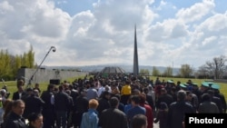People walk to the Tsitsernakabert memorial in Yerevan on April 24 during an annual commemoration of the 1915 mass killings of Armenians in Ottoman Turkey.
