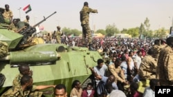 Thousands have kept up their sit-in outside the military headquarters in Khartoum.