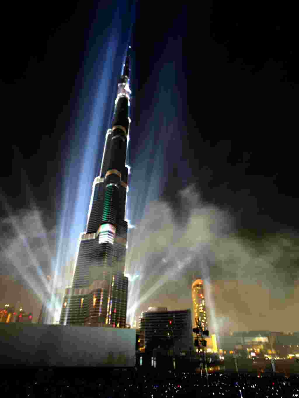Dubai's Burj Khalifa tower, the world's tallest skyscraper, is illuminated by lasers during its opening ceremony on January 4. Photo by Karim Sahib for AFP