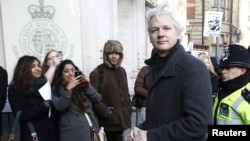 WikiLeaks founder Julian Assange (second from right) arrives at the Supreme Court in London on February 1.