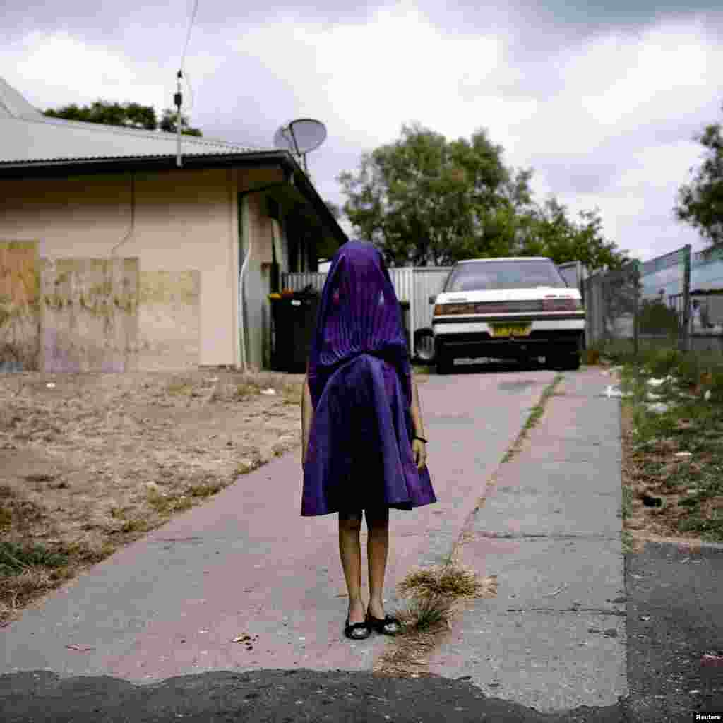 Raphaela Rosella, an Australian photographer of Oculi agency, won First Prize in the Portraits Category, Singles, with this portrait of Laurinda waiting in her purple dress for the bus that will take her to Sunday​ school in Moree, New South Wales, Australia.