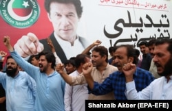 Supporters of Imran Khan celebrate as the National Assembly elects him as prime minister in Karachi on August 17.