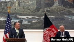 Afghan President Ashraf Ghani (R) speaks during a press conference with U.S. Secretary of State Mike Pompeo, at the presidential palace in Kabul on July 9.