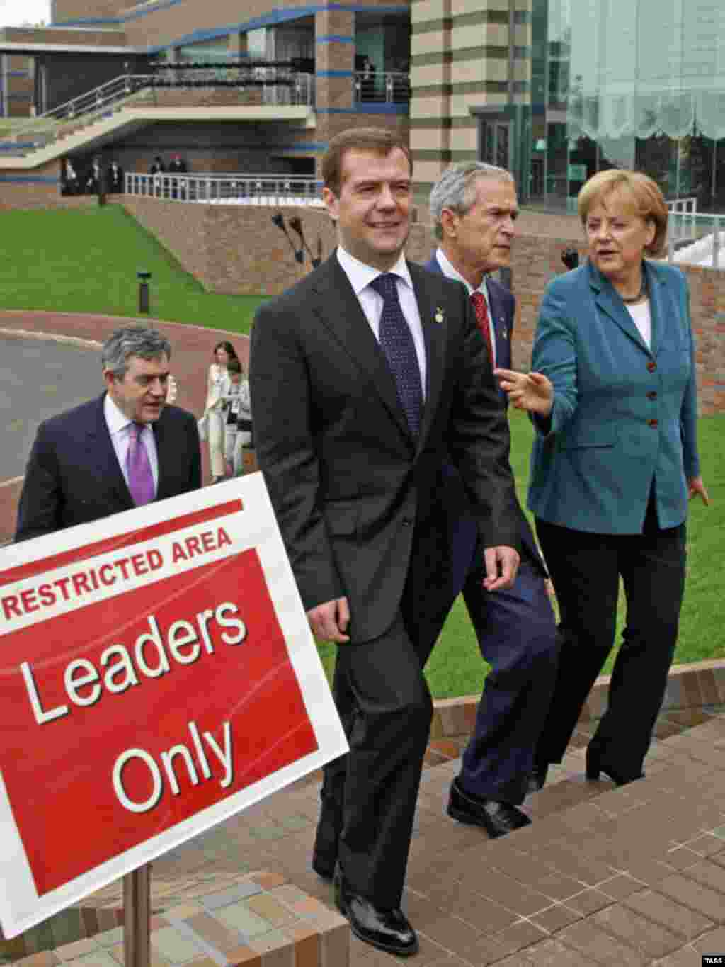 World leaders - Group of Eight meeting in Japan -- (left to right) British Prime Minister Gordon Brown, Russian President Dmitry Medvedev, U.S. President George W. Bush, and German Chancellor Angela Merkel at summit in Tokyo, July 9, 2008