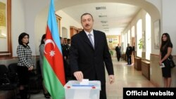 Azerbaijani President İlham Aliyev votes in elections in November.
