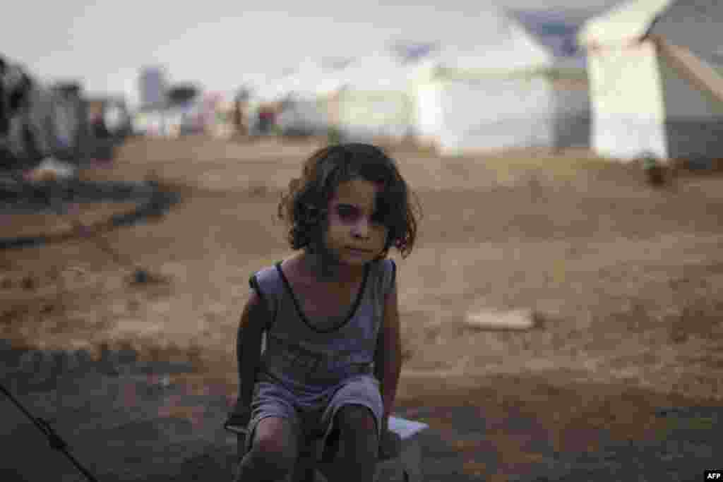 A young boy who fled fighting around Mosul with his family in the Hasan Shami camp for internally displaced people, Iraq, on November 14. (AFP/Achilleas Zavallis)