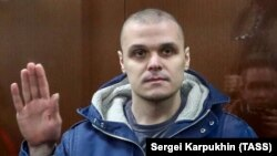 Russian protester Sergei Surovtsev, 30, was sentenced to 2 1/2 years in a penal colony for assaulting an officer during an anti-government rally in Moscow on July 27, 2019.